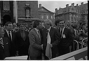 Nissan International Cycle Race..1986..01.10.1986..10.01.1986..1st October 1986..The Nissan Classic began today from Trinity College,Dublin. The offical race starter was The Taoiseach,Dr Garrett FitzGerald TD. He was accompanied by the Minister for Sport,Mr Sean Barrett TD..Sean Kelly was returning to defend his title but his opposition included Greg LeMond, the 1983 world champion and the winner of the Tour de France of the previous July. Roche was out due to his injured leg. Adri van der Poel was back with 1980 Tour de France winner and 1985 world champion Joop Zoetemelk. Teun van Vliet was back too. The winner of the green jersey of the Tour de France that July, Eric Vanderaerden was there as well as Australians Phil Anderson and Alan Peiper as well the Scottish cyclist Robert Millar...An Taoiseach,Dr Garret FitzGerald,greets the Lord Mayor of Dublin,Mr Bertie Ahern as Mr Gerard O'Toole ,Managing Director,Nissan Ireland looks on.