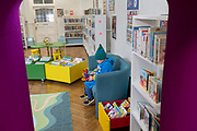 A young boy in the re-opened Carnegie Library on Herne Hill in south London which has opened its doors for the first time in almost 2 years, on 15th February 2018, in London, England. Closed by Lambeth council and occupied by protesters for 10 days in 2016, the library bequeathed by US philanthropist Andrew Carnegie has been locked ever since because, say Lambeth austerity cuts are necessary. A gym that locals say they dont want or need has been installed in the listed basement and actual library space a fraction as before and its believed no qualified librarians will be present to administer it. Protesters also believe this community building will ultimately sold off by Lambeth council for luxury homes.