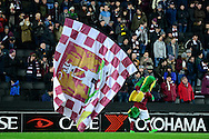 Clarence the Dragon, Northampton Town mascot waves a flag in front of the supporters during the The FA Cup Third Round Replay match between Milton Keynes Dons and Northampton Town at stadium:mk, Milton Keynes, England on 19 January 2016. Photo by Dennis Goodwin.
