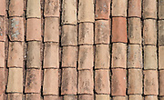 One of the few original roof tiles in Dubrovnik, Croatia. The city known as the.Pearl of the Adriatic was heavily shelled during the break-up of Yugoslavia in 1991..During the siege of Dubrovnik two-thirds of the town's old buildings were damaged..Today the roofs are a patchwork of restored and original tiles. The traditional clay tiles were originally shaped over a man's thigh. Dubrovnik, Croatia, 2005