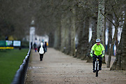 A cyclist cycles by St James' Park near Pall Mall street in London on Saturday, Mar 13, 2021, after the introduction of measures to bring the country out of lockdown by the end of March. Coronavirus has hit the UK hard, with the country recording more than 3m cases and 125,000 deaths linked to the disease. (VXP Photo/ Vudi Xhymshiti)