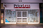 Closed down PriceLess Shoe shop in Middlesborough town centre, North Yorkshire, United Kingdom. Many small businesses have been forced to close during the economic slow-down.