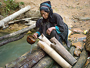 In the remote Akha Nuquie ethnic minority village of Ban Peryenxangmai, Phongsaly Province, Lao PDR, women's first task of the day is to collect water using a gourd scoop and carry it back to the village in traditional bamboo water carriers. One of the most ethnically diverse countries in Southeast Asia, Laos has 49 officially recognised ethnic groups although there are many more self-identified and sub groups. These groups are distinguished by their own customs, beliefs and rituals.