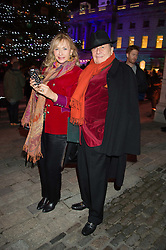 BARRY HUMPHRIES and LIZZIE SPENDER at the launch of Skate at Somerset House in association with Fortnum & Mason held at Somerset House, The Strand, London on 17th November 2015.