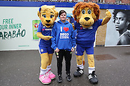 a Chelsea fan wearing a ' I love Diego Costa'  hoodie poses for a photo with mascots outside Stamford Bridge. Premier league match, Chelsea v Arsenal at Stamford Bridge in London on Saturday 4th February 2017.<br /> pic by John Patrick Fletcher, Andrew Orchard sports photography.