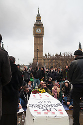 "London, February 14th 2015. A few dozen activists from Occupy Democracy gather at Parliament Sqyuuare to hold a vigil and funeral for British democracy, which they say has been killed by Parliaments apparent alliance with corporates at the expense of the ""99%"".  PICTURED: People listen to speakers with Big Ben as a backdrop.  // Photographer contact for payment details if not already on record: Tel 07966016 296, email paul@pau;ldaveycreative.co.uk."