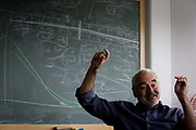Portrait of mathematician and Risk guru, Professor Sir David Spiegelhalter with blackboard workings of probability, at the Centre for Mathematical Sciences at the University of Cambridge. Sir David John Spiegelhalter (1953), OBE FRS, is a British statistician. In 2007 he was elected Winton Professor of the Public Understanding of Risk in the Statistical Laboratory, University of Cambridge and a Fellow of Churchill College, Cambridge. From the chapter entitled 'Possible Futures' and from the book 'Risk Wise: Nine Everyday Adventures' by Polly Morland (Allianz, The School of Life, Profile Books, 2015).