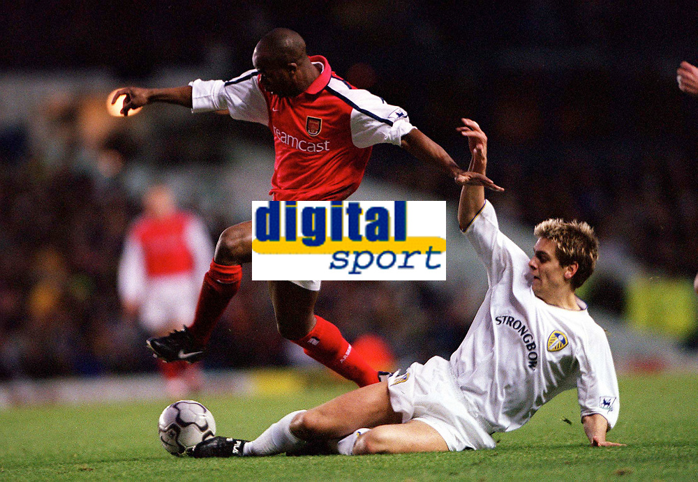Sylvian Wiltord (Arsenal) Jon Woodgate (Leeds United). Leeds United v Arsenal, F.A.Carling Premiership, 26/11/2000. Credit Colorsport / Stuart MacFarlane