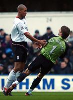 Zat Knight (Fulham) collides with Edwin Van Der Sar. Fulham v Tottenham Hotspur, Loftus Road, 31/01/2004, Premiership Football. Credit : Digitalsportt / Robin Hume.
