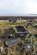 6-1-2014: Knocked headstones and uprooted graves paint a grimly scene in Ballinskelligs Graveyard in County Kerry after  storms on Monday morning.<br /> Picture by Don MacMonagle