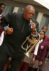 Oct 02, 2004; New York, NY, USA; African Jazz legend HUGH MASEKELA performs with the Boys' & Girls' Choirs of Harlem during the ceremony for the African Burial Ground, 'Africans in the Americans:Celebrating the Ancestral Heritage' which commemorates the contributions of the ancesters who were reinterred last October as well as 20,000 other enslaved Africans interred on the African Burial Ground in Lower Manhattan. In 1991, during construction work at 290 Broadway excavators found the largest Colonial-era cemetery forAfrican Americans most of them slaves.    (Credit Image: © Nancy Kaszerman/ZUMAPRESS.com)