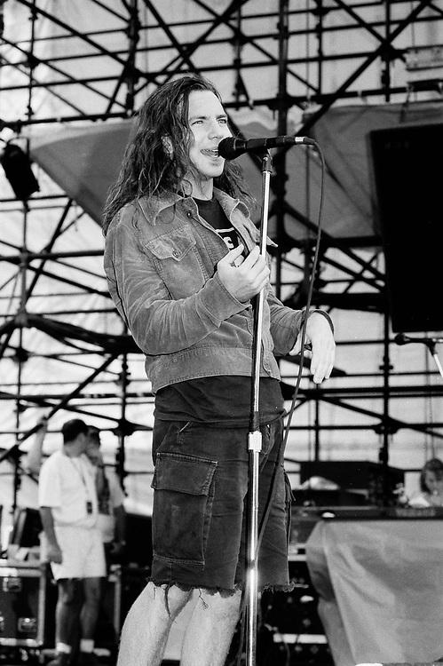 Eddie Vedder In Waterloo Village<br /> <br /> WATERLOO VILLAGE - AUGUST 11: Eddie Vedder of Pearl Jam performs at Lollapalooza on August 11, 1992, in Stanhope, New Jersey. ©Lisa Lake