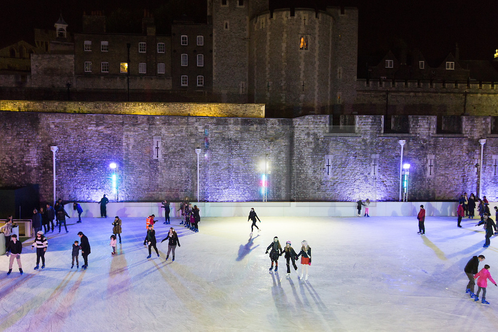 © Licensed to London News Pictures. 14/11/2013. London, UK. People ice skate at night on the Tower of London ice rink on 14 November 2013 at press night. The Tower of London ice rink opens on 16 November 2013. Photo credit : Vickie Flores/LNP