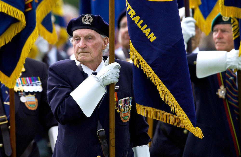 Veterans of the D-Day Landings with their flags in a parade at the start of the 60th Anniversary Commemorations.