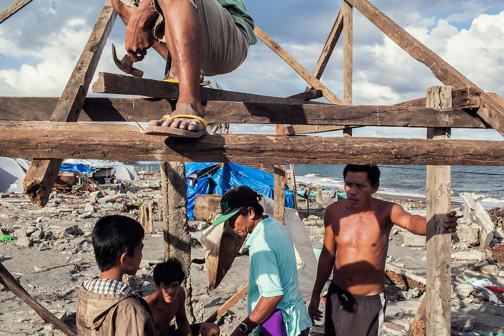 A family builds a new home using scraps that they found on the shore in Tanauan.