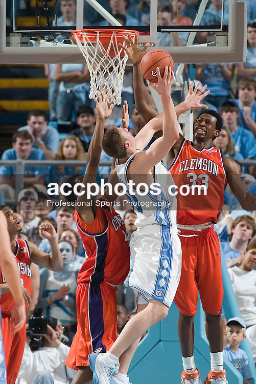 04 February 2006:  Freshmen center Tyler Hansbrough (50) defended by Akin Akingbala (33) during a Clemson Tigers 61-76 loss to the North Carolina Tarheels, in the Dean Smith Center in Chapel Hill, NC.