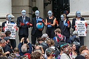"""Activists dyed their hands on red-blood colour to illustrate as they say Britain's wealth is """"blood wealth"""" during an Extinction Rebellion fifth day of two-week protest campaign outside the Bank of England in London on Friday, Aug 27, 2021.<br /> Activists said that the wealth of this country is """"blood wealth"""" as to this day the country use its financial and armed power to exploit resources elsewhere. (VX Photo/ Vudi Xhymshiti)"""