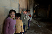 Family of Syrian refugees from Homs who arrived on March 4 in Wadi Khaled, libanon. They live in a cold and unsafe house that is still under construction.