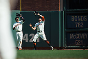 San Francisco Giants center fielder Gorkys Hernandez (66) and San Francisco Giants right fielder Hunter Pence (8) nearly collide while catching a pop fly against the Arizona Diamondbacks at AT&T Park in San Francisco, California, on August 6, 2017. (Stan Olszewski/Special to S.F. Examiner)