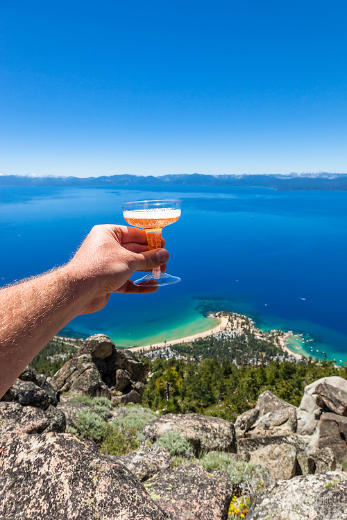 """""""Cheers to Lake Tahoe"""" - Photograph of a champaign toast high above Sand Harbor and beautiful Lake Tahoe."""
