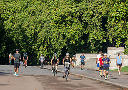 © Licensed to London News Pictures. 20/08/2020. London, UK. Calm after the storm. Cyclist enjoy the warm sunshine in Hyde Park in Westminster this morning with highs of 25c expected for London and the South East, a day after the UK was battered by Storm Ellen which saw heavy downfalls and high winds. However, weather forecasters have predicted high winds for tomorrow as the UK continues to feel the force of the Atlantic storm. Photo credit: Alex Lentati/LNP