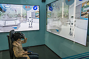 Hi-tech virtual and robotic interactive environment, 3D virtal experience in property retail, face recognition entry, unmanned opoerations, created at China Construction Bank, Shanghai, China