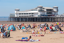 © Licensed to London News Pictures.  24/06/2018; Weston-super-Mare, North Somerset, UK. Crowds on the beach by the pier at Weston Air Festival, during the RAF centenary year. Air displays take place over the Seafront and Beach Lawns at Weston-super-Mare, including the Battle of Britain Memorial Flight and the Red Arrows display team. Photo credit: Simon Chapman/LNP