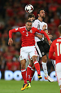 Jazz Richards of Wales (l) jumps for a header with Martin Harnik of Austria. Wales v Austria , FIFA World Cup qualifier , European group D match at the Cardiff city Stadium in Cardiff , South Wales on Saturday 2nd September 2017. pic by Andrew Orchard, Andrew Orchard sports photography