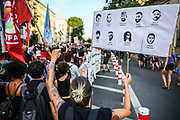 People take part in a memorial demonstration to the victims of the Hanau terror attack, in Berlin, Germany, August 19, 2020. Thousands of protesters marched through the German capital's Neuköln district in remembrance of the Hanau shootings, in which ten people were killed and five others wounded. The shooting spree was committed on February 19, 2020 by a far-right extremist targeting two shisha bars and kiosks at the Hessian city of Hanau near Frankfurt. The gunman was identified as 43-year-old Tobias Rathjen. The majority of the victims were Germans with migrant backgrounds, among the victims was also the perpetrator's mother. (Photo by Omer Messinger)