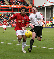 Photo: Mark Stephenson.<br />Walsall v Barnet. Coca Cola League 2. 24/02/2007. Walsall's Kevin Harper (L) fights for the ball with Adam Gross