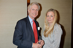 TRISTAN MILLINGTON-DRAKE and ASTRID HARBORD at a private screening of The Anonymous People in aid of Action on Addiction held at The Bulgari Hotel, 171 Knightsbridge, London on 20th May 2015.