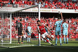 Arsenal's Pierre-Emerick Aubameyang celebrates scoring his side's first goal of the game during the Premier League match at the Emirates Stadium, London.