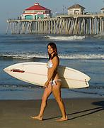 Woman In Bikini At The Huntington Beach Pier With Surf Board