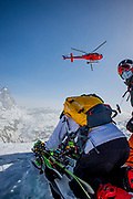 BREUIL-CERVINIA, ITALY - APRIL 02 2021: free-riders meet for one of the lastest heliski ride of the winter season in Cervinia, Valle d'Aosta (Italy). This winter season has been extremely challenging for the ski industry due to the Covid19 Pandemic and restrictions by the Italian Government. In fact, ski lifts were kept closed for the whole 2021 season; the exact calculation of missed incomes of commercial activities evolving around winter tourism is still to be calculated. Heliski has been one of the few exceptions for ski enthusiasts.