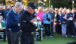 Honorary starters Jack Nicklaus and Gary Player and the gallery observe a moment of silence for Arnold Plamer during the the honorary start of the Masters at Augusta National Golf Club on Thursday, April 6, 2017, in Augusta, Ga. (Photo by Brant Sanderlin/Atlanta Journal-Constitution/TNS)  *** Please Use Credit from Credit Field ***