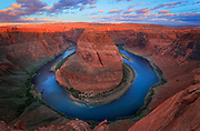 Horseshoe Bend on the Colorado River near Page, Arizona ..... Horseshoe Bend is a horseshoe-shaped meander of the Colorado River located near the town of Page, Arizona, in the United States. Horseshoe Bend is located 5 miles downstream from the Glen Canyon Dam and Lake Powell within Glen Canyon National Recreation Area, about 4 miles southwest of Page. It is accessible via hiking a 1.5-mile round trip from U.S. Route 89, but an access road also reaches the geological structure, as it is part of a state park. Horseshoe Bend can be viewed from the steep cliff above. The overlook is 4,200 feet (1,300 m) above sea level, and the Colorado River is at 3,200 feet (980 m) above sea level, making it a 1,000-foot (300 m) drop
