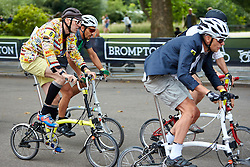 © Licensed to London News Pictures. 01/08/2015. LONDON, UK. Competitors, some in fancy dress, take part in the 10th Brompton World Championship bike race. The annual event sees over 500 competitors use the folding bicycles to race round St James' Park for up to 8 laps. Photo credit: Cliff Hide/LNP