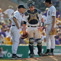 06 June 2009:  Rice head coach Wayne Graham talks with catcher Craig Manuel and pitcher Ryan Berry on the mound during a 5-3 victory by the LSU Tigers over the Rice Owls in game two of the NCAA baseball College World Series, Super Regional played at Alex Box Stadium in Baton Rouge, Louisiana. The Tigers with the win advance to next week's College Baseball World Series in Omaha, Nebraska.