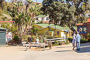 Tourists Walking Around Crystal Cove Historic District