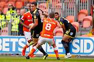 Wimbledon midfielder Anthony Hartigan (8) is tightly marked by Blackpool midfielder Jay Spearing (8)  during the EFL Sky Bet League 1 match between Blackpool and AFC Wimbledon at Bloomfield Road, Blackpool, England on 20 October 2018.