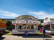30 JULY 2019 - DES MOINES, IOWA:  A customer walks up to the Westmoreland Concessions corn dog stand on the Iowa State Fair fairgrounds. The Iowa State Fair Is one of the largest state fairs in the United States and runs for 10 days. In 2019, it runs from August 8 to 18. More than one million people attend the fair every year. Most of the food concessions at the fair don't open until August 3, when exhibitors arrive, but the Westmoreland Concessions corn dog stand opened on July 28. One of the stand's workers said a lot of people drive out to the fairgrounds the week before the fair to buy corn dogs because the fair is so crowded and concession lines are very long.    PHOTO BY JACK KURTZ