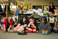 "5th grade students at Woodland Heights Elementary School learn about the ""980"" an autonomous robot from Jake Drouin with IRobot on Wednesday afternoon.  (Karen Bobotas/for the Laconia Daily Sun)"