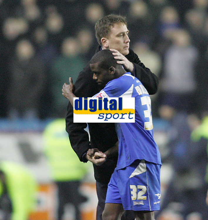 Photo: Lee Earle.<br /> Millwall v Everton. The FA Cup. 07/01/2006. Millwall manager Dave Tuttle congratulates theur goal scorer Marvin Williams at the end of the match.