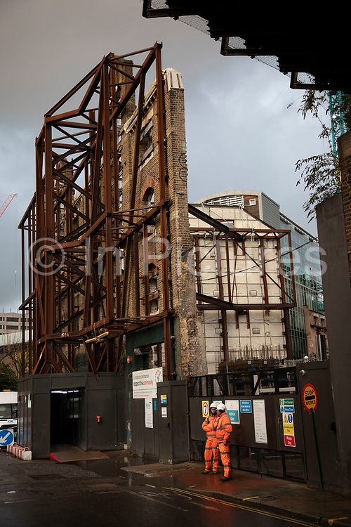 Tall brick facade of a conservation building redevelopment construction site at Borough on 27th November 2019 in London, England, United Kingdom. Older buildings which may be listed have to undergo strict planning preservations during development, so that the original architectural characteristics are preserved.