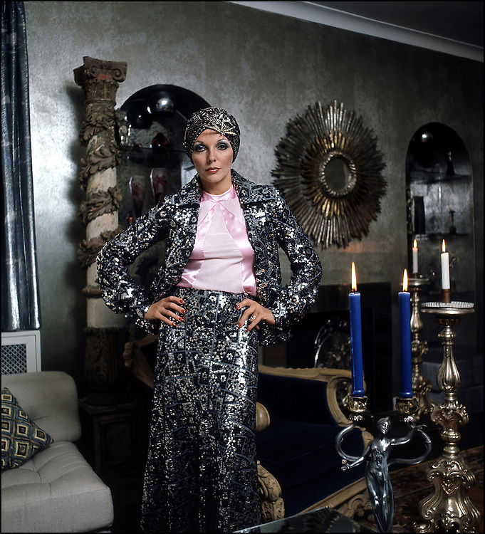 British actress Joan Collins seen in London wearing a Theo Porter designer suit in 1975. Photographed by Terry Fincher