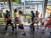 21 OCTOBER 2014 - BANGKOK, THAILAND:  Commuters in Bangkok get off the Chao Phraya River Express Boat at Central Pier, the intersection with the BTS Skytrain.   PHOTO BY JACK KURTZ
