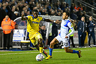 Deji Oshilaja (4) of AFC Wimbledon is challenged by Kyle Bennett (23) of Bristol Rovers during the EFL Sky Bet League 1 match between Bristol Rovers and AFC Wimbledon at the Memorial Stadium, Bristol, England on 23 October 2018.