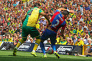 Bradley Johnson battles Joel Ward during the Barclays Premier League match between Norwich City and Crystal Palace at Carrow Road, Norwich, England on 8 August 2015. Photo by Craig McAllister.