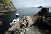 Boatmen leave visiting tourists disembark at the only access point to Skellig Michael, the larger of The Skellig Rocks off the Kerry coast..Picture by Don MacMonagle ....info: photo 2007