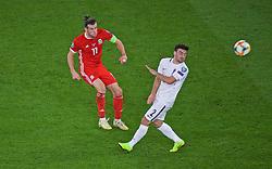 CARDIFF, WALES - Friday, September 6, 2019: Wales' captain Gareth Bale (L) and Azerbaijan's Gara Garayev during the UEFA Euro 2020 Qualifying Group E match between Wales and Azerbaijan at the Cardiff City Stadium. (Pic by Paul Greenwood/Propaganda)